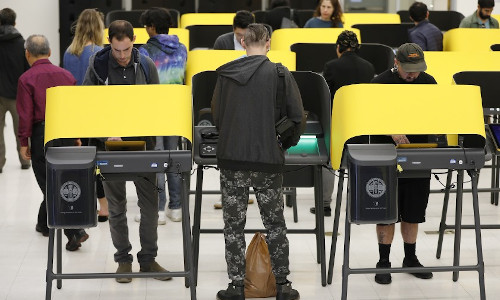 People using new voting machines in Los Angeles.